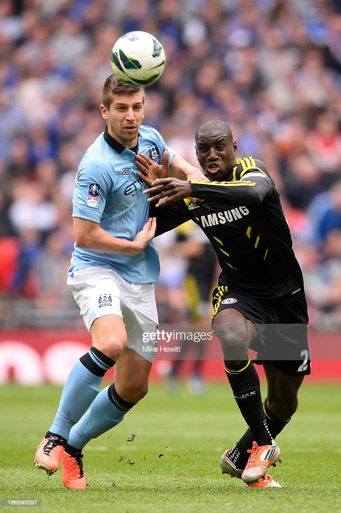 Matija Nastasic of Manchester City battles with <a gi-track='captionPersonalityLinkClicked' href=/galleries/search?phrase=Demba+Ba&family=editorial&specificpeople=4510297 ng-click='$event.stopPropagation()'>Demba Ba</a> of Chelsea during the FA Cup with Budweiser Semi Final match between Chelsea and Manchester City at Wembley Stadium on April 14, 2013 in London, England.