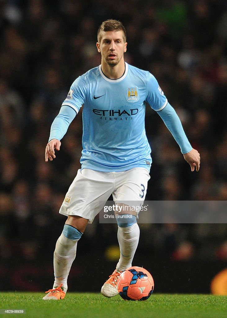 Matija Nastasic of Manchester City in action during the Budweiser FA Cup Third Round Replay match between Manchester City and Blackburn Rovers at the Etihad Stadium on January 15, 2014 in Manchester, England.