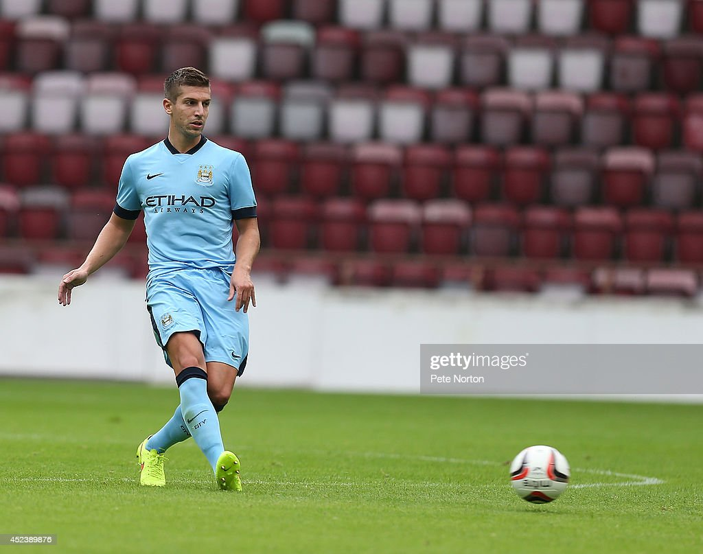 Matija Nastasic of Manchester City in action during the Pre Season Friendly match between Hearts and Manchester City at Tyncastle Stadium on July 18, 2014 in Edinburgh, Scotland.