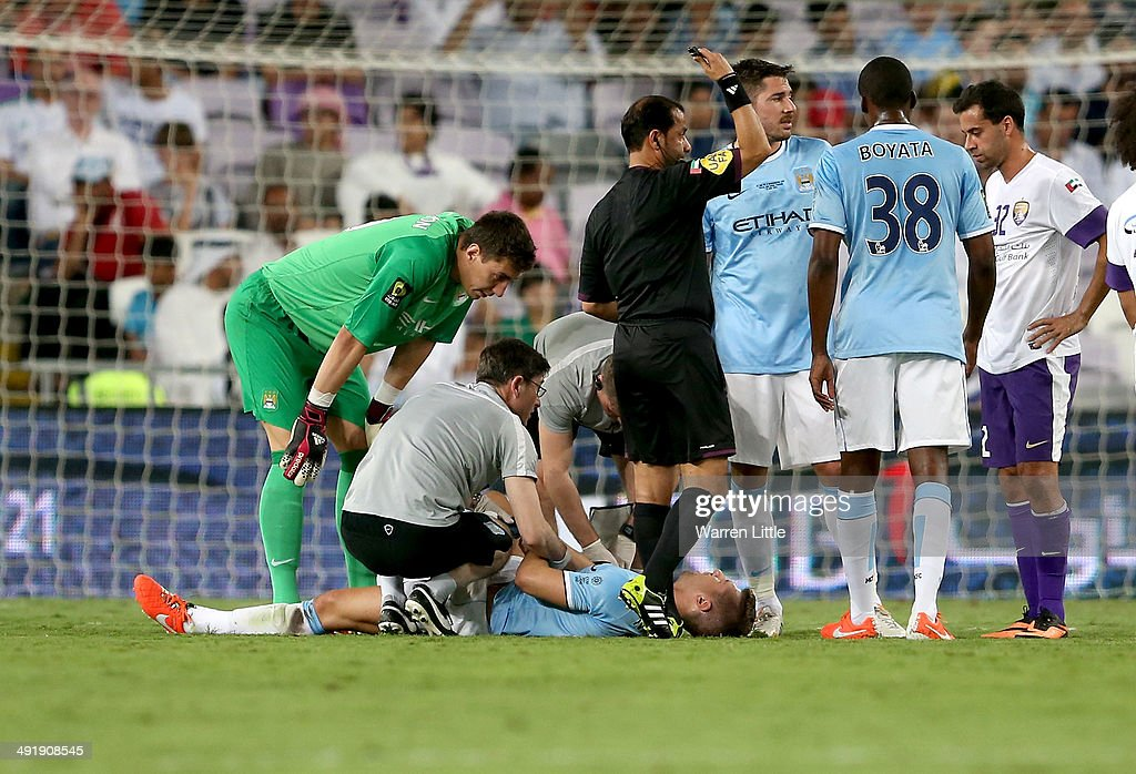 Matija Nastasic of Manchester City lies injurjed and eventually leaves the pitch during the friendly match between Al Ain and Manchester City at Hazza bin Zayed Stadium on May 15, 2014 in Al Ain, United Arab Emirates.