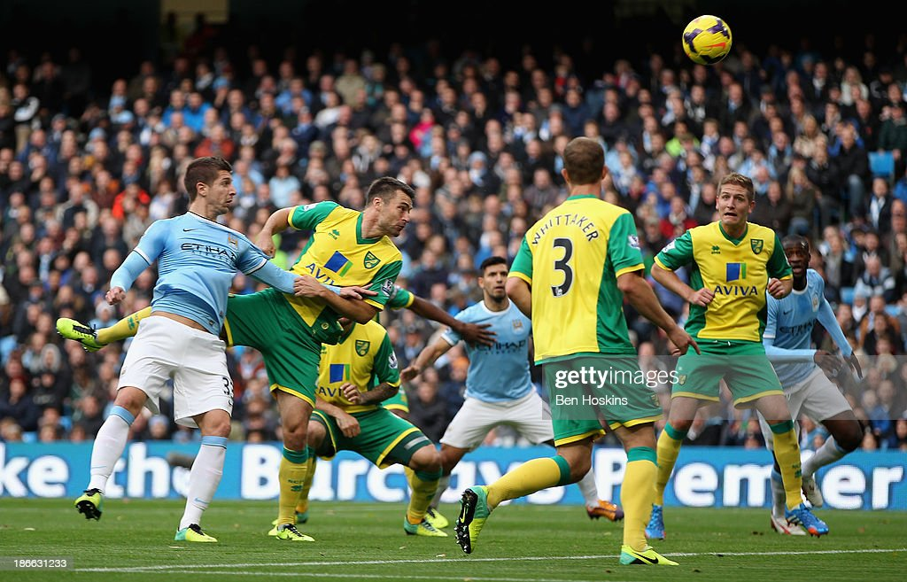 Matija Nastasic of Manchester City scores the third goal during the Barclays Premier League match between Manchester City and Norwich City at Etihad Stadium on November 2, 2013 in Manchester, England.