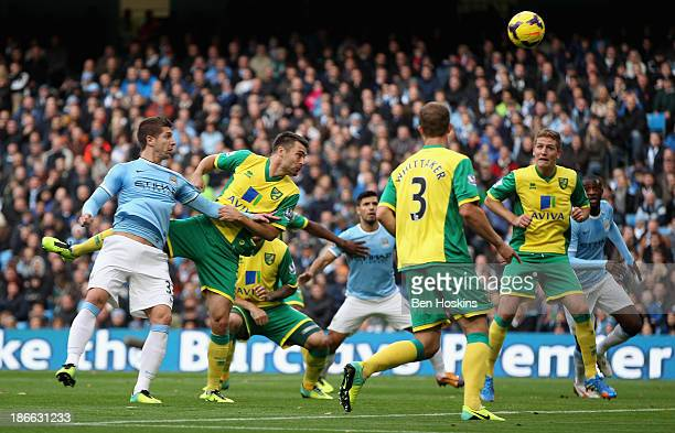 Matija Nastasic of Manchester City scores the third goal during the Barclays Premier League match between Manchester City and Norwich City at Etihad...