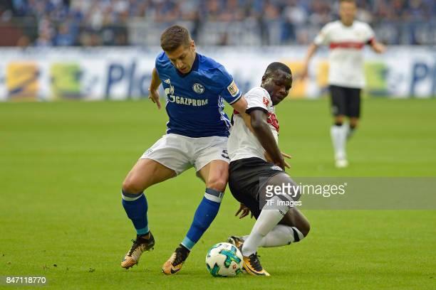 Matija Nastasic of Schalke and Chadrac Akolo of Stuttgart battle for the ball during the Bundesliga match between FC Schalke 04 and VfB Stuttgart at...