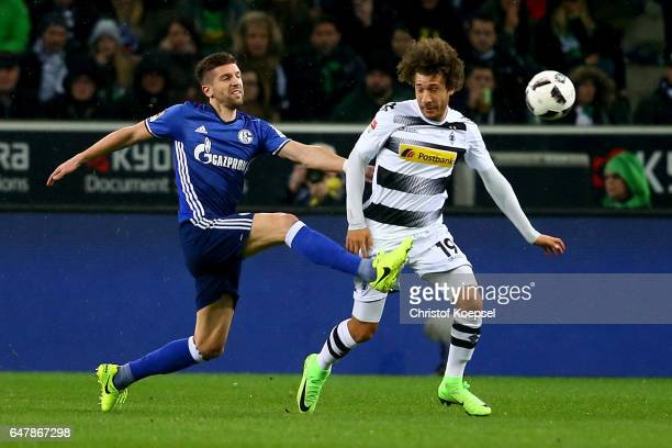 Matija Nastasic of Schalke challenges Fabian Johnson of Moenchengladbach during the Bundesliga match between Borussia Moenchengladbach and FC Schalke...
