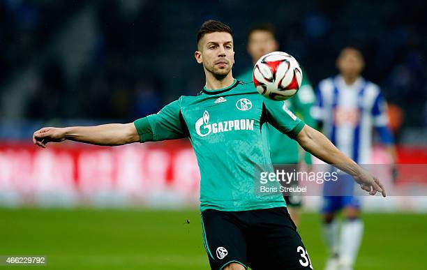 Matija Nastasic of Schalke runs with the ball during the Bundesliga match between Hertha BSC and FC Schalke 04 at Olympiastadion on March 14 2015 in...