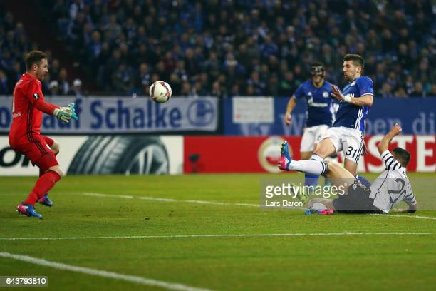 Matija Nastasic of Schalke scores an own goal against goalkeeper Ralf Faehrmann under pressure from Efthymis Koulouris of PAOK during the UEFA Europa...