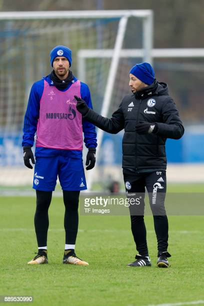 Matija Nastasic of Schalke speaks with Head coach Domenico Tedesco of Schalke during a training session at the FC Schalke 04 Training center on...