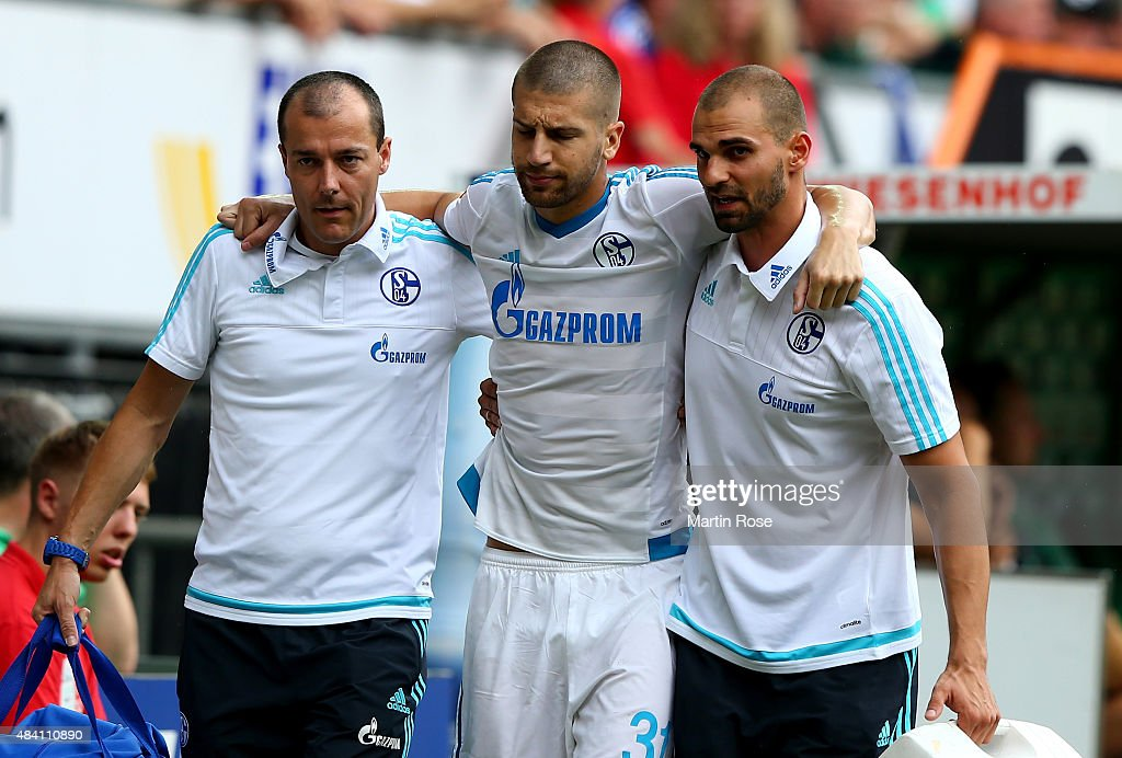 Matija Nastasic of Schalke walks injured off the pitch uring the Bundesliga match between SV Werder Bremen and Schalke 04 at Weserstadion on August 15, 2015 in Bremen, Germany.