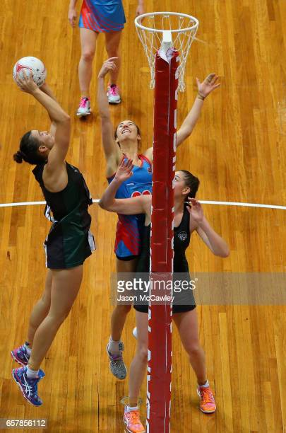 Matilda Garrett of the Magpies grabs a rebound during the round six ANL match between the Netball NSW Waratahs and the Tasmanian Magpies at Sydney...