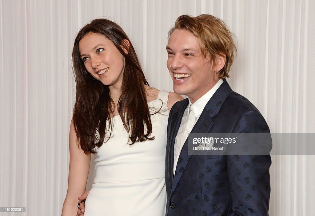 Matilda Lowther (L) and Jamie Campbell Bower arrive at the Jameson Empire Awards 2014 at The Grosvenor House Hotel on March 30, 2014 in London, England.