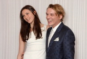 Matilda Lowther and Jamie Campbell Bower arrive at the Jameson Empire Awards 2014 at The Grosvenor House Hotel on March 30 2014 in London England