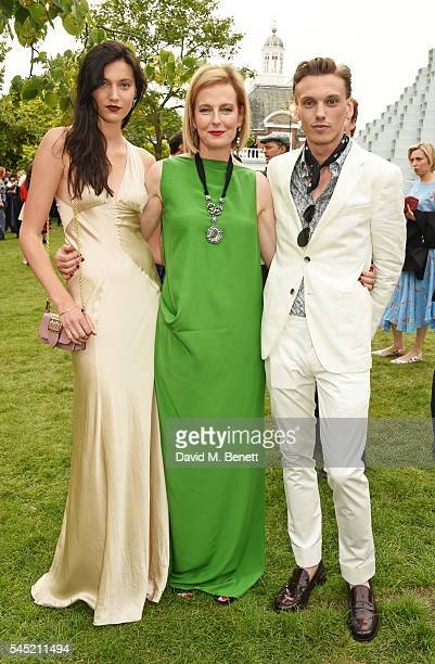 Matilda Lowther Julia PeytonJones and Jamie Campbell Bower attend The Serpentine Summer Party cohosted by Tommy Hilfiger on July 6 2016 in London...