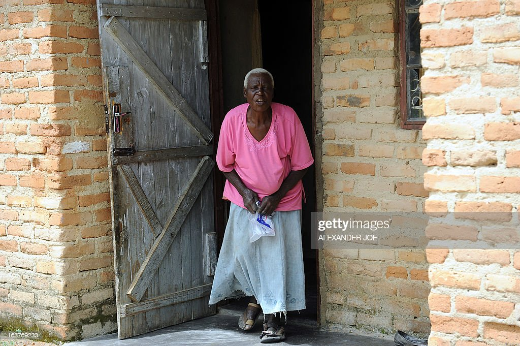 Matilda Mahlatini, 76, talks on March 15, 2013 outside her house in the village of Chinamhora, Zimbabwe. Mahlatini will not be joining hundreds of thousands of Zimbabweans voting in a referendum on March 16 on whether to adopt a new charter to pave way for new elections and a possible end to a shaky power-sharing government. The widow who ekes a living on a small plot in Cheza village in Chinamhora, 60 kilometres north-east of Zimbabwe, says she only heard about the draft charter, has no knowledge about its contents and that her welfare takes priority over the vote. 'I will be chasing away the monkeys and baboons,' the grey-haired Mahlatini told AFP referring to the marauding animals that besiege fields in the village in search of fresh corn. 'If I go to vote all of my mealies will be eaten and what am I going to eat myself ?' Her only hope is that the vote will change things 'especially the economy.'