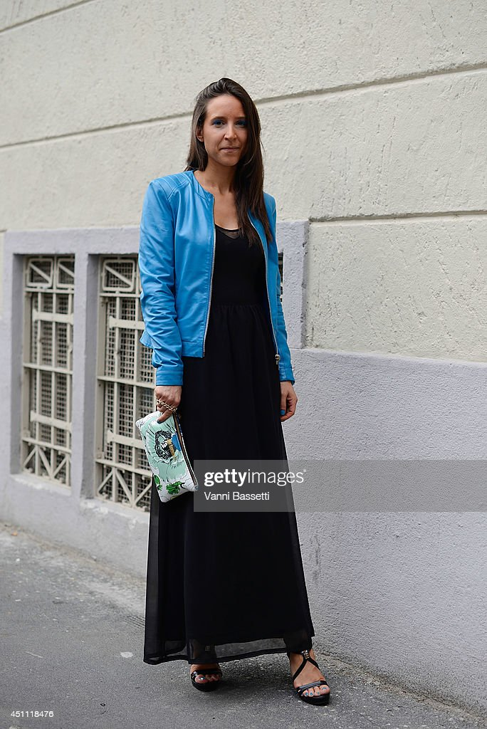 Matilde Bini is seen wearing a Zara dress, Dirk Bikkembergs jacket, clutch and shoes before Dirk Bikkemebergs show on June 23, 2014 in Milan, Italy.