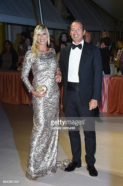 Matilde Brandi and Marco Costantini attend the Opening Dinner during the 71st Venice Film Festival on August 27 2014 in Venice Italy