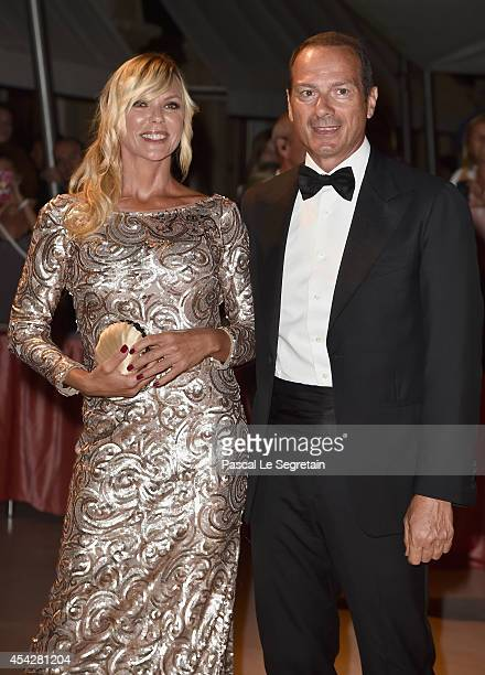 Matilde Brandi and Marco Costantini attends the Opening Dinner during the 71st Venice Film Festival on August 27 2014 in Venice Italy