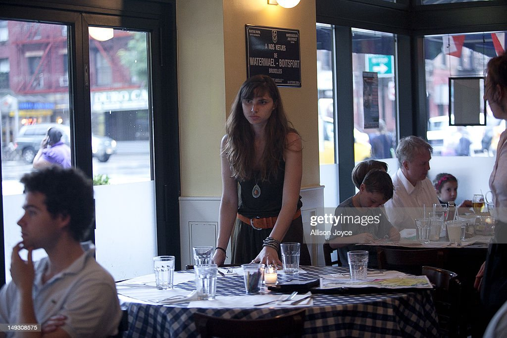 Matilde Hoffman clears a table while working part time as a hostess at 'Petite Abeille' June 22, 2012 in New York City. Matilda graduated from University of Southern California in December of 2011 with a bachelors degree in neuroscience. Since graduating she has applied to over 30 different jobs, gone on 3 interviews, and had no luck finding a full time job. In the meantime she has been working two part time hostess jobs and volunteering with New York Cares. In June, on a whim, she applied to a one year medical science program at Drexel University at was recently accepted. ''I was tired of the job search. All this looking for a job, volunteering and shuffling around to two part time jobs was getting stressful. If that's the only opportunity I have, if nothing else comes my way, I should do it. If this is what life has brought to me at the moment I should take it.'' she said. From 2000 to 2010 the number of waiters and waitresses ages 18 to 30 with college degrees increased 81 percent according to the U.S. Census Bureau. Educated bartenders, dishwashers in that age group doubled. Recently the Associated Press reported that ''About 1.5 million, or 53.6 percent, of bachelor's degree-holders under the age of 25 last year were jobless or underemployed, the highest share in at least 11 years.''