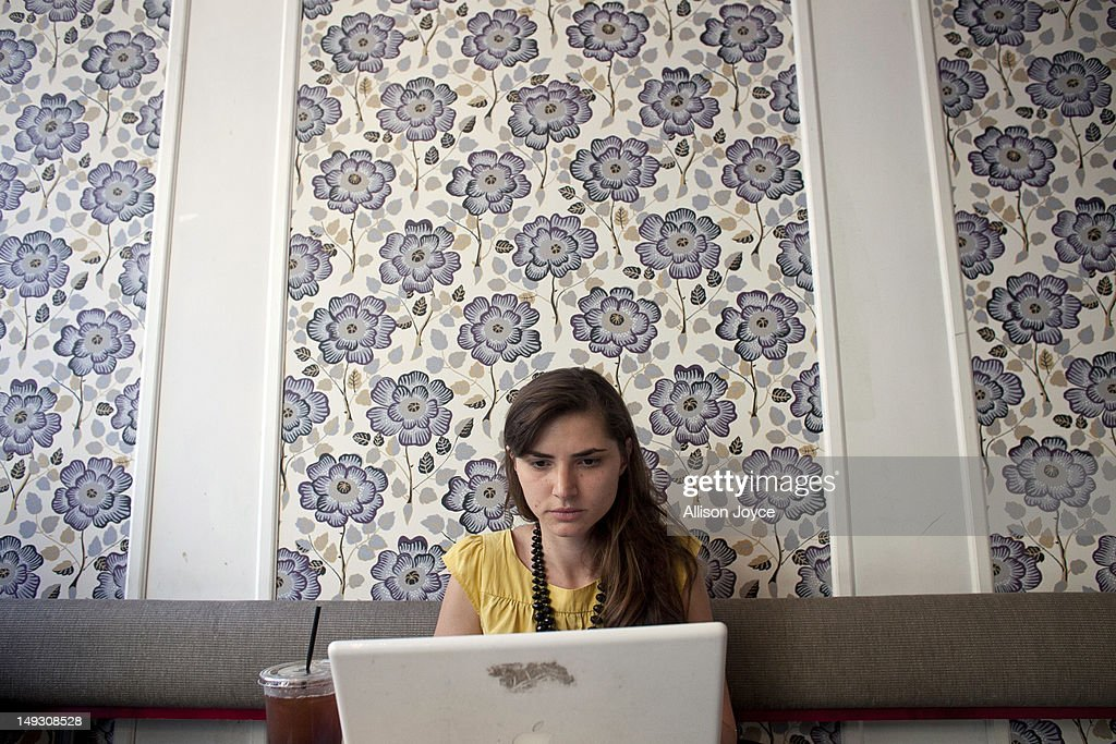 Matilde Hoffman works on her computer at a coffee shop July 25, 2012 in New York City. Matilda graduated from University of Southern California in December of 2011 with a bachelors degree in neuroscience. Since graduating she has applied to over 30 different jobs, gone on 3 interviews, and had no luck finding a full time job. In the meantime she has been working two part time hostess jobs and volunteering with New York Cares. In June, on a whim, she applied to a one year medical science program at Drexel University at was recently accepted. ''I was tired of the job search. All this looking for a job, volunteering and shuffling around to two part time jobs was getting stressful. If that's the only opportunity I have, if nothing else comes my way, I should do it. If this is what life has brought to me at the moment I should take it.'' she said. From 2000 to 2010 the number of waiters and waitresses ages 18 to 30 with college degrees increased 81 percent according to the U.S. Census Bureau. Educated bartenders, dishwashers in that age group doubled. Recently the Associated Press reported that ''About 1.5 million, or 53.6 percent, of bachelor's degree-holders under the age of 25 last year were jobless or underemployed, the highest share in at least 11 years.''