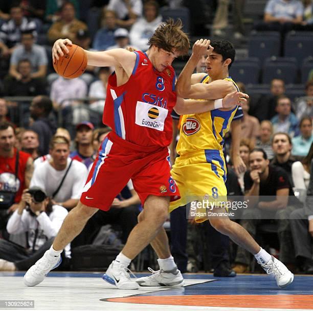 Matjaz Smodis of CSKA Moscow drives against Lioir Elyahu of Maccabi Tela Aviv during an NBA Europe Live friendly game between CSKA Moscow and Maccabi...