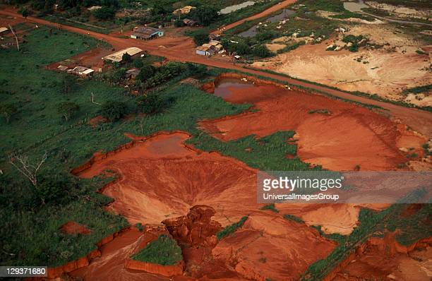 Mato Grosso Peixoto de Azevedo Aerial view over landscape with severe damage/pollution from gold mining operations clearly visible over former Panara...
