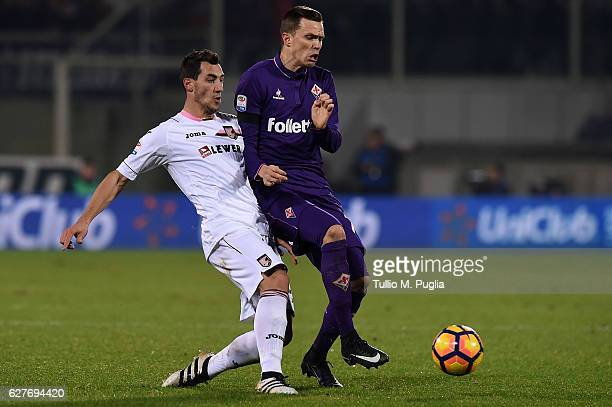 Mato Jajalo of Palermo and Josip Ilicic of Fiorentina compete for the ball during the Serie A match between ACF Fiorentina and US Citta di Palermo at...