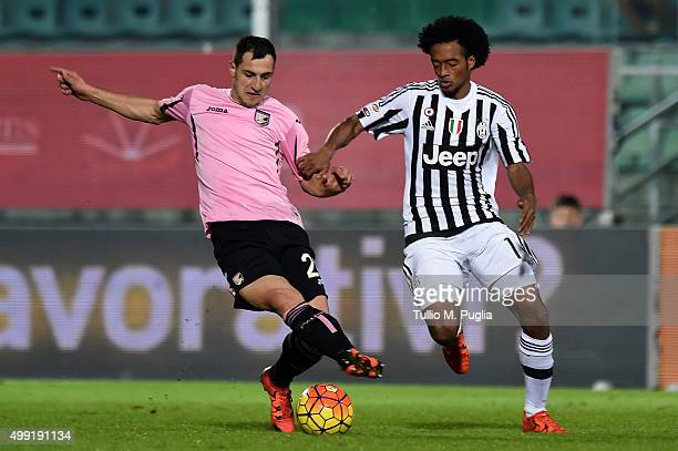 Mato Jajalo of Palermo and Juan Cuadrado of Juventus compete for the ball during the Serie A match between US Citta di Palermo and Juventus FC at...