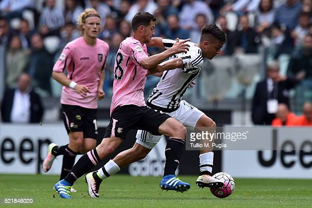 Mato Jajalo of Palermo and Paulo Dybala of Juventus compete for the ball during the Serie A match between Juventus FC and US Citta di Palermo at...