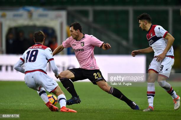 Mato Jajalo of Palermo is challanged by Andrea Berberis and Andrea Nalini of Crotone during the Serie A match between US Citta di Palermo and FC...