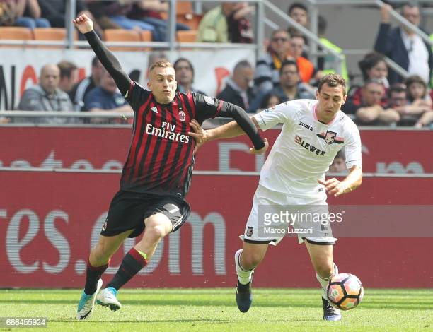 Mato Jajalo of US Citta di Palermo competes for the ball with Gerard Deulofeu of AC Milan during the Serie A match between AC Milan and US Citta di...