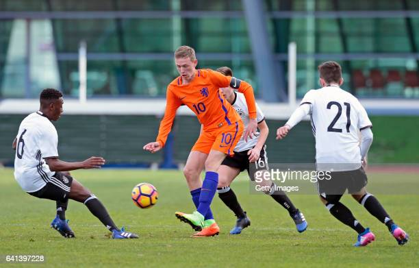MatondoMerveille Papela and Erkan Eyibil of Germany U16 challenges Wouter Burger of Netherlands U16 during the UEFA Development Tournament Match...