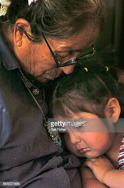 Matriarch Helen Nez holds grand– daughter Kylie Nez has had a lot of heart ache in her life burying six of her ten children who died from Navajo...