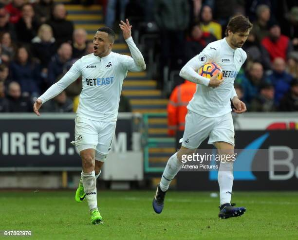 Matrin Olsson of Swansea City celebrates his goal with coscorer Fernando Llorente during the Premier League match between Swansea City and Burnley at...