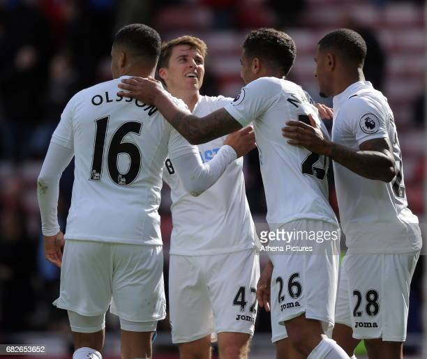 Matrin Olsson Tom Carroll Kyle Naughton and Luciano Narsingh Swansea City celebrate their win during the Premier League match between Sunderland and...