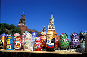 Matrioshkas representing Russian President Vladimir Putin in front of the Savior clock tower above the fortifications facing the Red Square