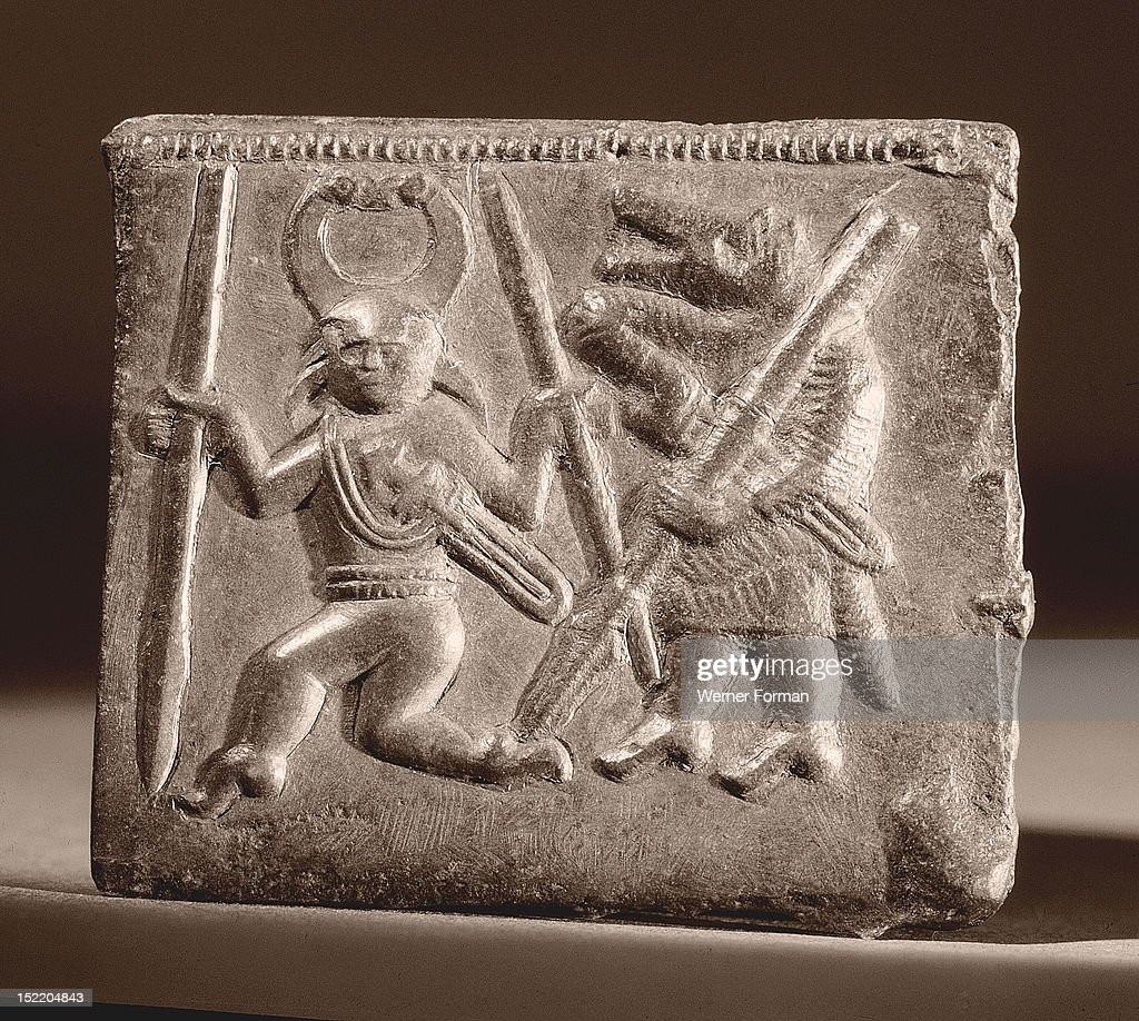 Matrix used in the manufacture of helmet plaquesThe dancing figures berserkers wear a helmet whose horns terminate in birds heads his companion wears...