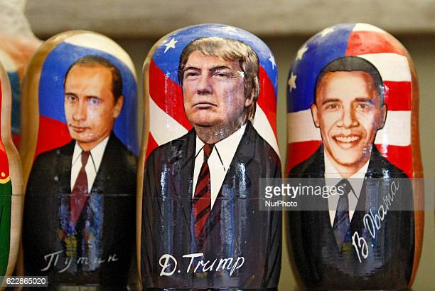 Matryoshka dolls with the portrait of US Presidentelect Donald Trump US President Barack Obama and Russian President Vladimir Putin is displayed on...