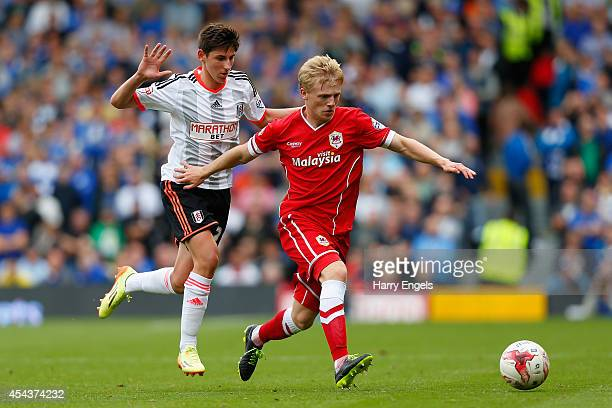 Mats Daehli of Cardiff City is challenged by Emerson Hyndman of Fulham during the Sky Bet Championship match between Fulham and Cardiff City at...