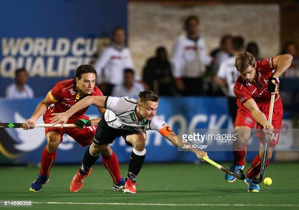 Mats Grambusch of Germany battles with Augustin Meurmans of Belgium during day 4 of the FIH Hockey World League Men's Semi Finals Pool B match...