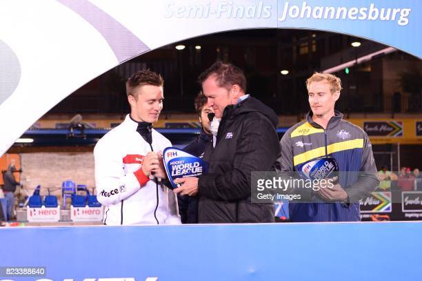 Mats Grambusch of Germany receives the trophy from Jason McCracken FIH Chief Executive during day 9 of the FIH Hockey World League Men's Semi Finals...