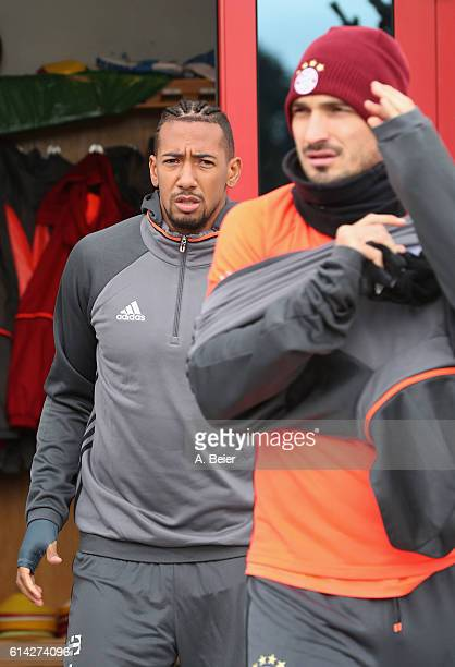 Mats Hummels and Jerome Boateng of FC Bayern Muenchen arrive for a training session at the Saebener Strasse training ground on October 13 2016 in...