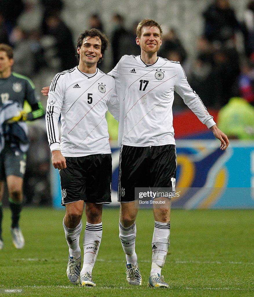 Mats Hummels (L) and Per Mertesacker of Germany react after winning the international friendly match between France and Germany at Stade de France on February 6, 2013 in Paris, France.