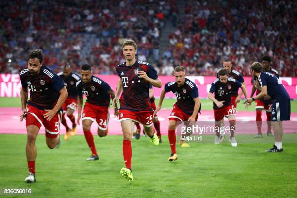 Mats Hummels and Thomas Mueller of Bayern Muenchen warm up prior the Bundesliga match between FC Bayern Muenchen and Bayer 04 Leverkusen at Allianz...