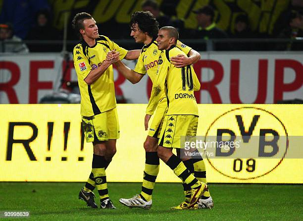 Mats Hummels celebrates with his team mates Kevin Grosskreutz and Mohamed Zidan of Dortmund after scoring his team's fourth goal during the...