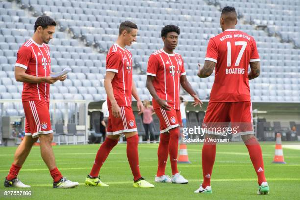 Mats Hummels Fabian Benko David Alaba and Jerome Boateng of FC Bayern Muenchen arrive for the group picture during the team presentation at Allianz...