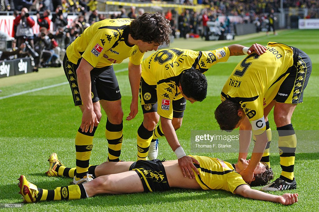 <a gi-track='captionPersonalityLinkClicked' href=/galleries/search?phrase=Mats+Hummels&family=editorial&specificpeople=595395 ng-click='$event.stopPropagation()'>Mats Hummels</a>, <a gi-track='captionPersonalityLinkClicked' href=/galleries/search?phrase=Lucas+Barrios&family=editorial&specificpeople=4142497 ng-click='$event.stopPropagation()'>Lucas Barrios</a> and <a gi-track='captionPersonalityLinkClicked' href=/galleries/search?phrase=Sebastian+Kehl&family=editorial&specificpeople=486611 ng-click='$event.stopPropagation()'>Sebastian Kehl</a> of Dortmund celebrate with <a gi-track='captionPersonalityLinkClicked' href=/galleries/search?phrase=Neven+Subotic&family=editorial&specificpeople=2234315 ng-click='$event.stopPropagation()'>Neven Subotic</a> (buttom) during the Bundesliga match between Borussia Dortmund and SV Werder Bremen at Signal Iduna Park on April 3, 2010 in Dortmund, Germany.