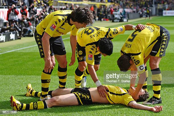 Mats Hummels Lucas Barrios and Sebastian Kehl of Dortmund celebrate with Neven Subotic during the Bundesliga match between Borussia Dortmund and SV...