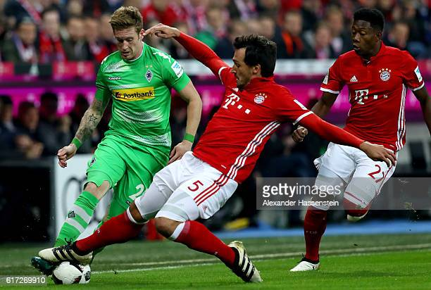 Mats Hummels of Bayern Muenchen and Andre Hahn of Gladbach battle for the ball during the Bundesliga match between Bayern Muenchen and Borussia...