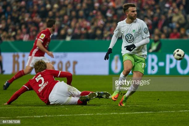 Mats Hummels of Bayern Muenchen and Borja Mayoral of Wolfsburg battle for the ball during the DFB Cup Round Of 16 match between Bayern Muenchen and...