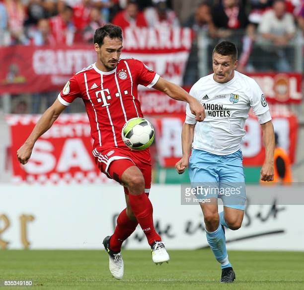Mats Hummels of Bayern Muenchen and Daniel Frahn of Chemnitz controls the ball during the DFB Cup first round match between Chemnitzer FC and FC...