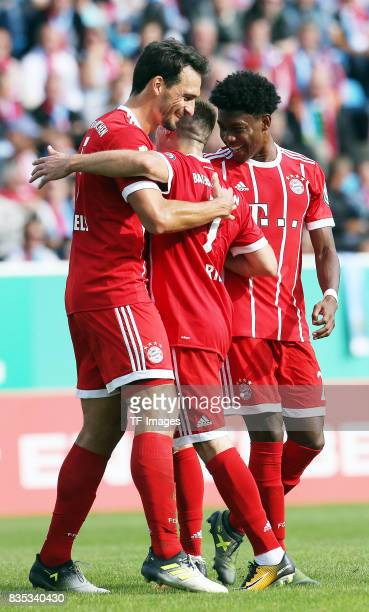 Mats Hummels of Bayern Muenchen and David Alaba of Bayern Muenchen and Franck Ribery of Bayern Muenchen celebrate a goal during the DFB Cup first...